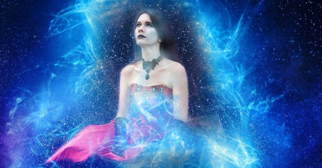 Seated woman with black necklace and gloves with a red dress surrounded by blue energy in the universe