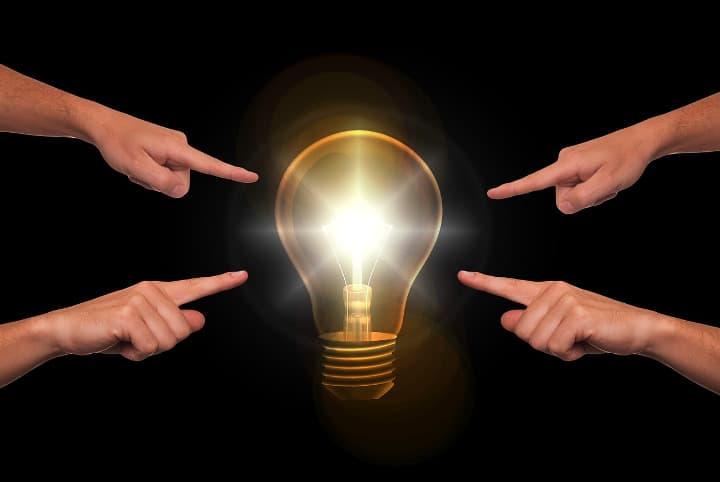 fingers pointing at lightbulb