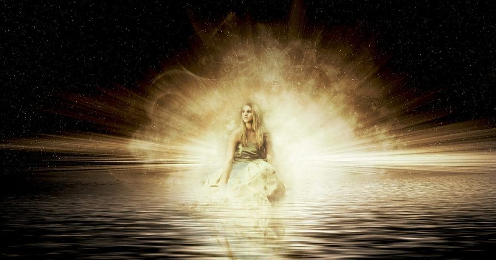Woman in sea with spiritual power behind her